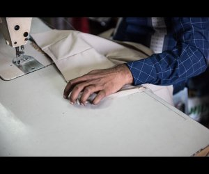 Tailor Sewing Clothes