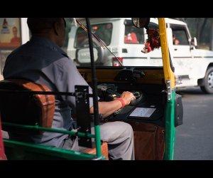 Driver riding Autorickshaw